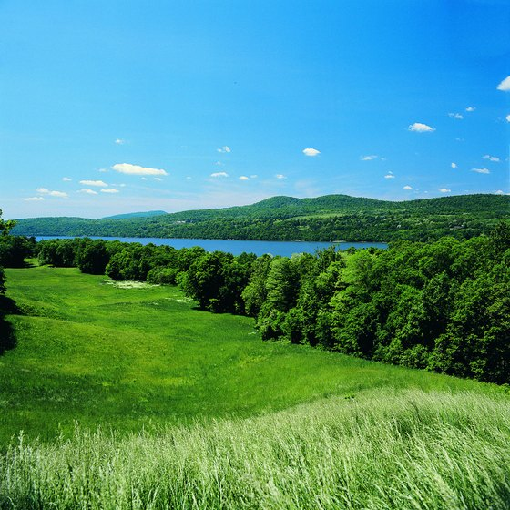 Green meadows stretch alongside the Hudson River Valley north of New York City.