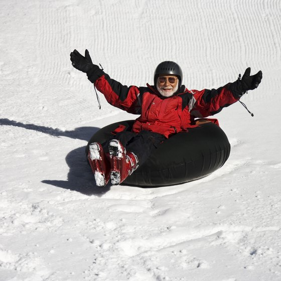 Winter tubing on a snow-covered trail.