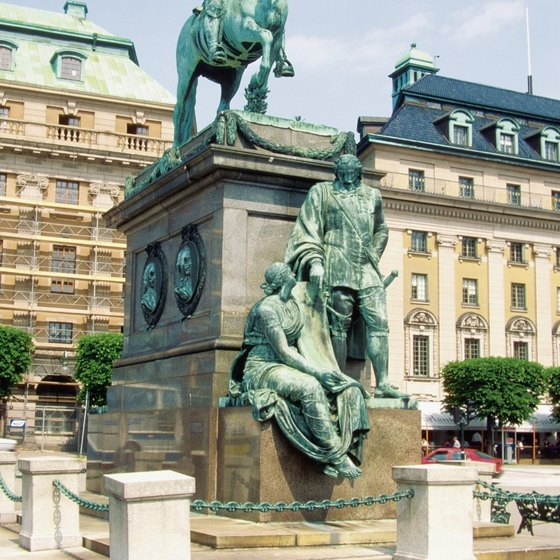 The statue of King Karl X Gustav of 17th century Sweden rises from the fountain at Stortoget Square in the center of Malmo.