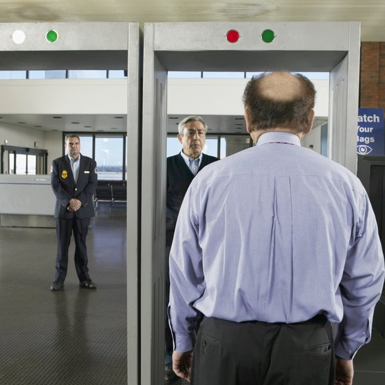 Remove belts, hats, watches and shoes at the metal detector; essentially everything besides your clothes.