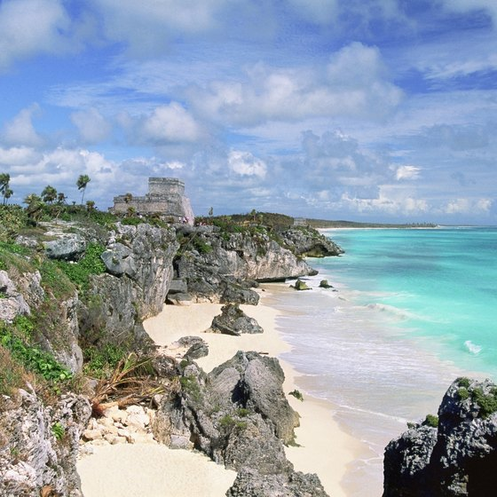 The ruins of Tulum are perched above a quiet beach.