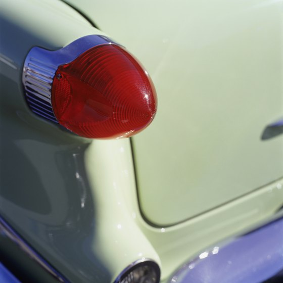 Sculptured taillight on a classic car.