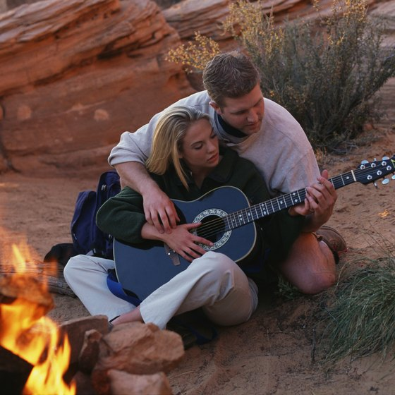 For campfire romance, make music together, metaphorically or with a real guitar.