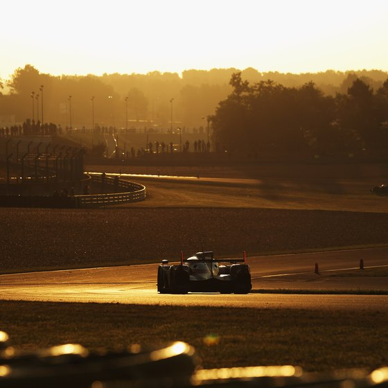 The sun rises over a racer in the annual 24 Hours of Le Mans race.