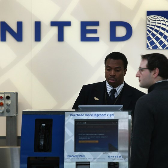 United Airlines allows business class and premium passengers extra checked baggage.