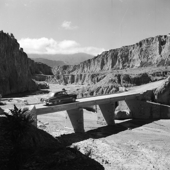 A bridge in the barren Bolivian countryside.