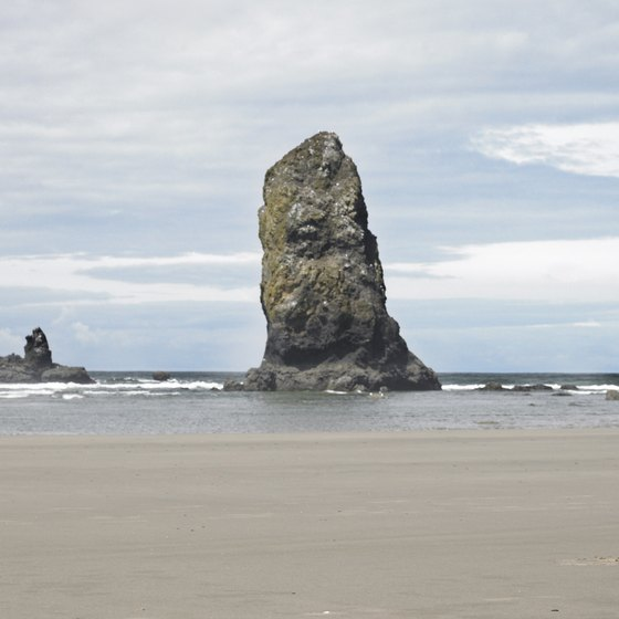 Vacationers enjoy walking on the sandy beaches of the Oregon coast.
