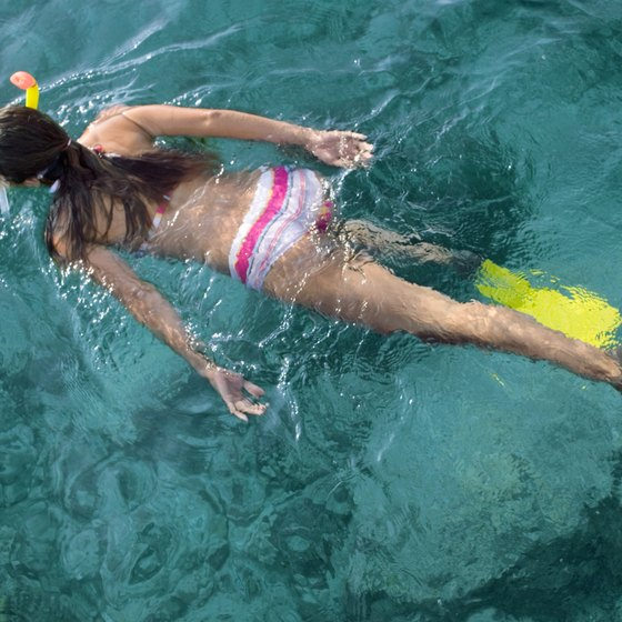 Fins help you navigate in the water when snorkeling.