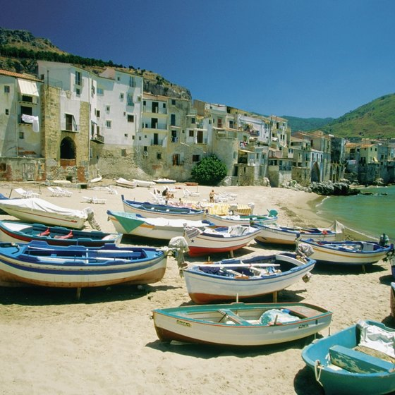 Colorful fishing boats dot the Sicilian shore.