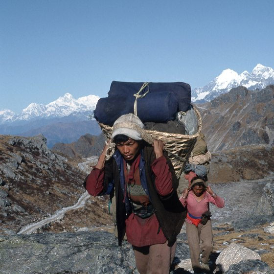Sherpas lead trekkers on overnight adventures in Nepal.