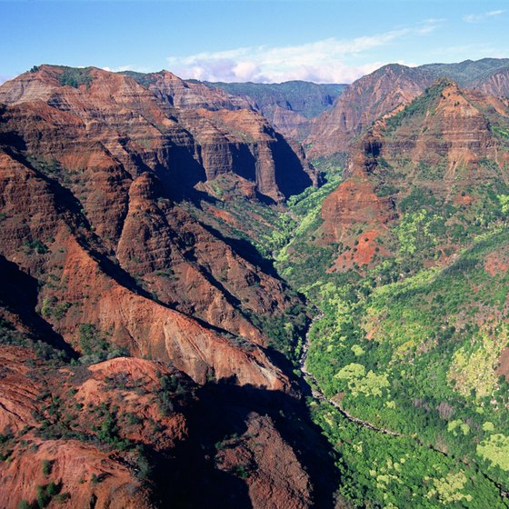 Hiking in beautiful Waimea Canyon in Kauai, Hawaii is reminiscent of the Grand Canyon.