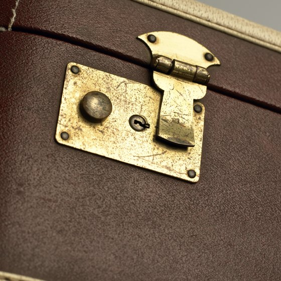 Old suitcase latches wear out, but you can often repair them.