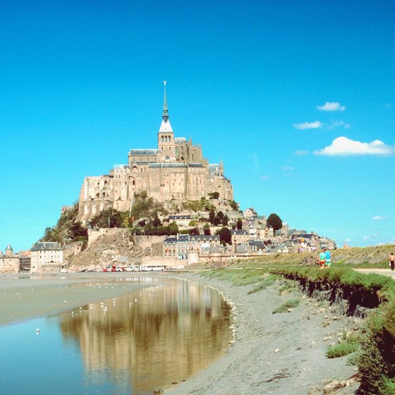 Mont Saint-Michel, a Medieval abbey, seems to rise from the sea off France's Normandy shore.