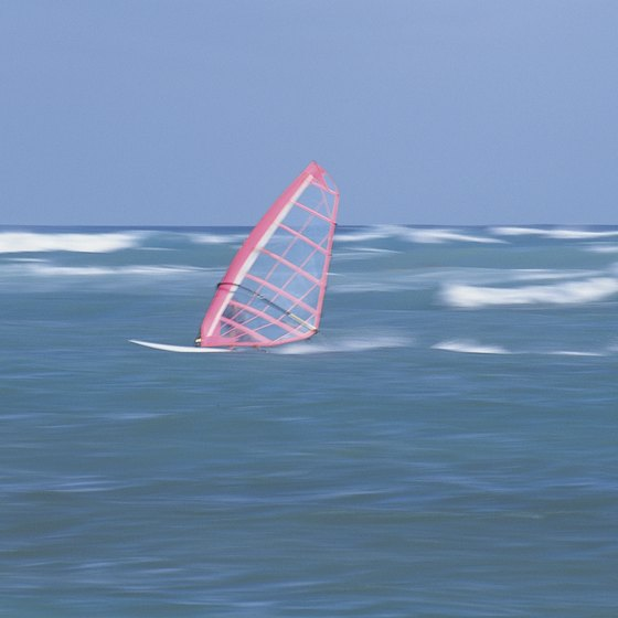 Windsurfing is a popular sport around Sebastian Inlet.