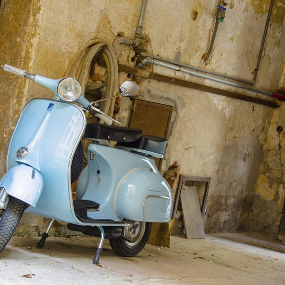 Hop on a Vespa, the most Italian of all motorcycles, and take a tour.