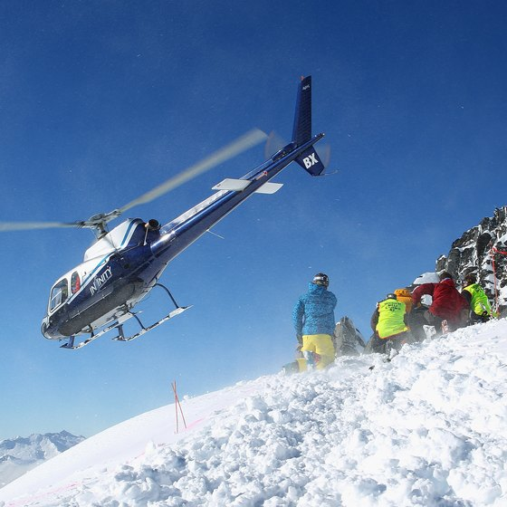 Snowboarders seeking high adventure beyond the lift lines should consider a heli-tour.