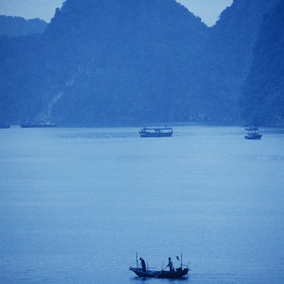 Ha Long Bay is a UNESCO World Heritage Site located in Vietnam's Gulf of Tonkin.
