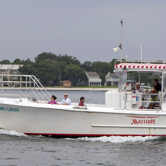 Vacationers cruise the Panama City coast on the Bay Point Lady.