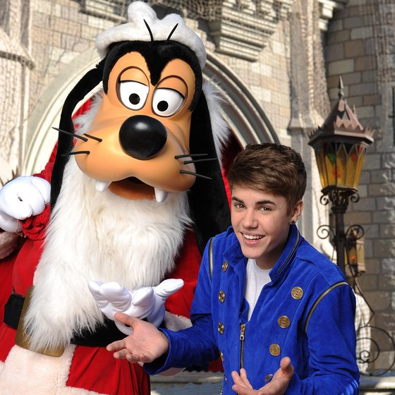 Goofy and Justin Bieber welcomed holiday crowds to Disneyland in December 2011.