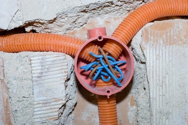 Wires can be pulled through existing conduit with a cable puller.