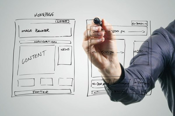 A man is designing his website on a board.