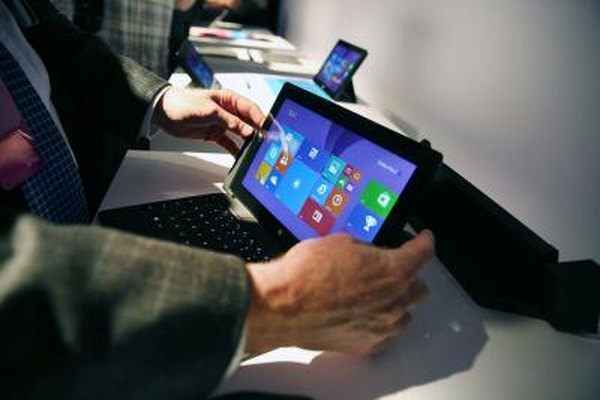A man uses a Microsoft Surface tablet computer at a promotional event