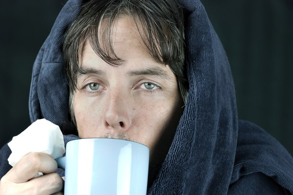 Sick Man With Tissue Drinking From Mug
