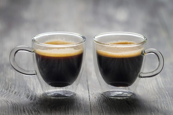 Closeup of two small cups with espresso