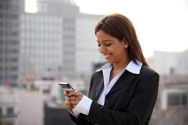 Businesswoman texting on cellphone