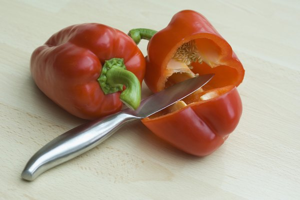 Knife and sliced red bell pepper