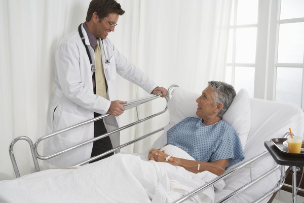 Patient in hospital bed speaking to Doctor