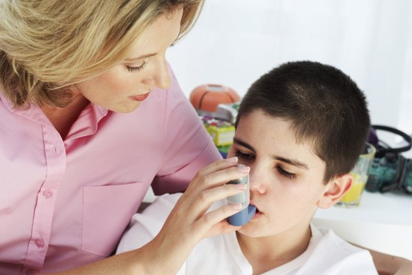 mother putting an inhaler in her son's mouth (8-9)