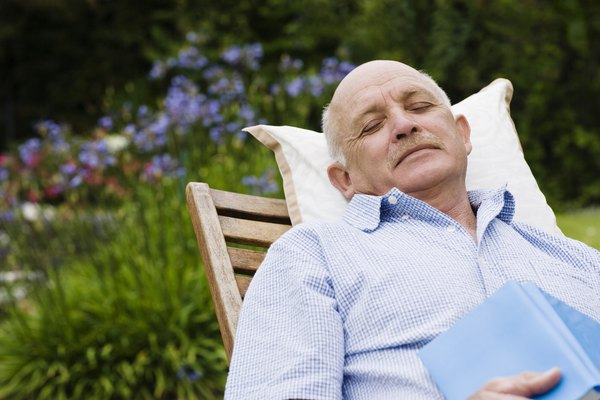 Man napping in lounge chair