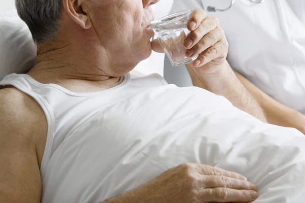 Man in hospital drinking water