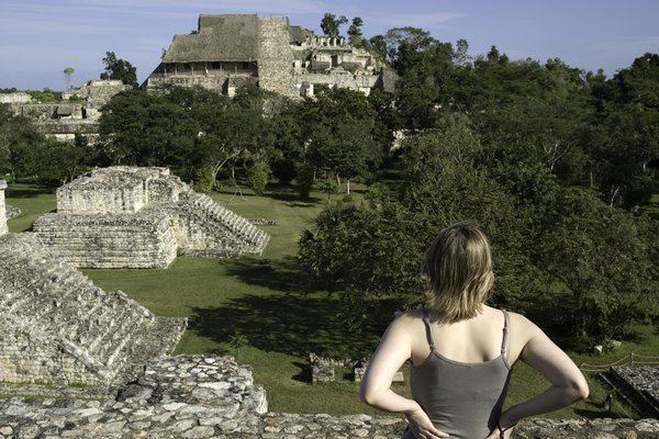 Woman looking over Maya Ruins
