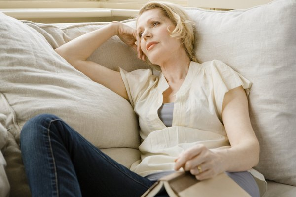 Woman resting on couch