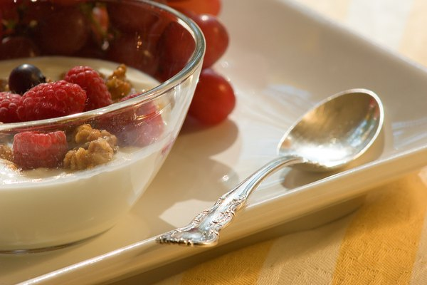 Bowl of yogurt with nuts and berries