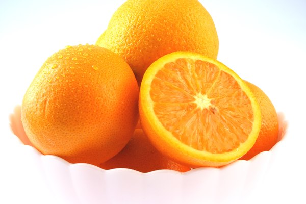Close up of a bowl of oranges, partial view