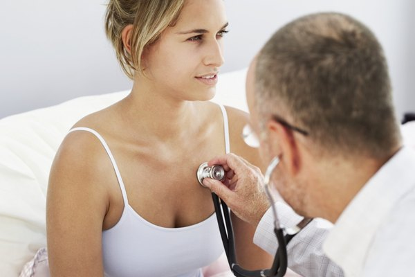 doctor examining a woman with a stethoscope
