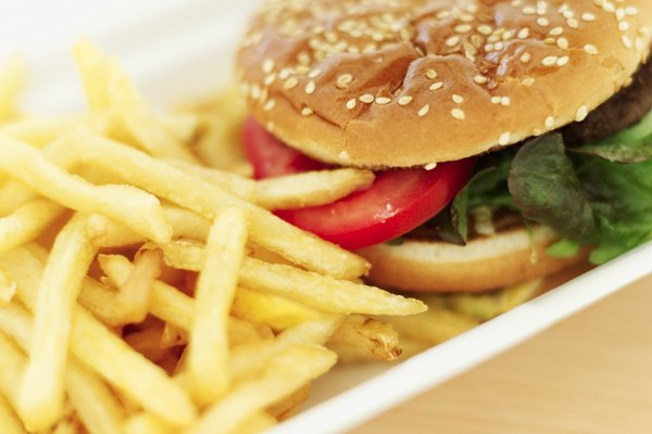 close-up of a hamburger with french-fries on a plate