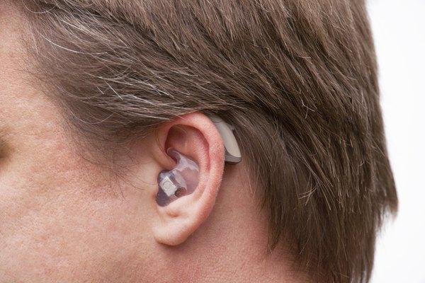 Close up on an ear with hearing aid.