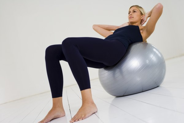 Woman reclining on exercise ball