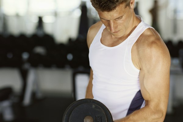 Close-up of a mid adult man exercising with dumbbell