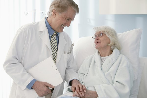 Doctor comforting patient in hospital