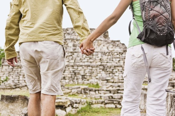 Couple holding hands at Tulum ruins, Quintana Roo, Mexico