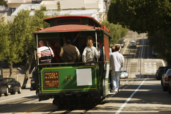 Rear view of four people in a trolley car, San Francisco, California, USA