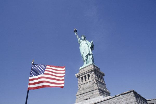 American flag and Statue of Liberty, New York, USA, (Low angle view)