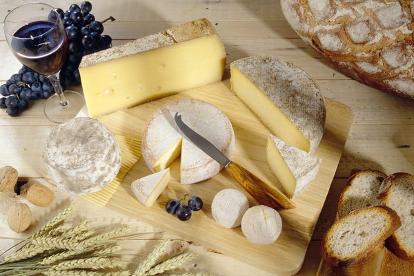 Cheeses on cutting board