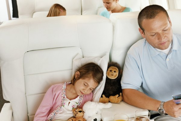 Family Sitting in an Aircraft Cabin and Passengers Sitting in the Background