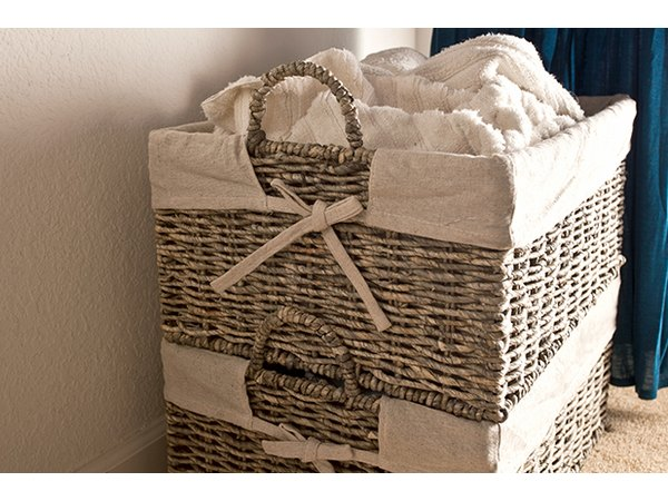 Stack hamper baskets to save space and separate laundry by color or type.